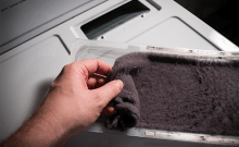 clean clogged dryer lint trap