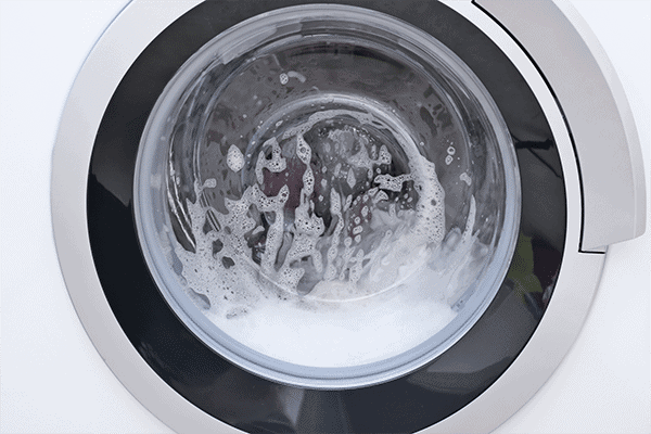 can you us regular detergent in high-efficiency washing machine