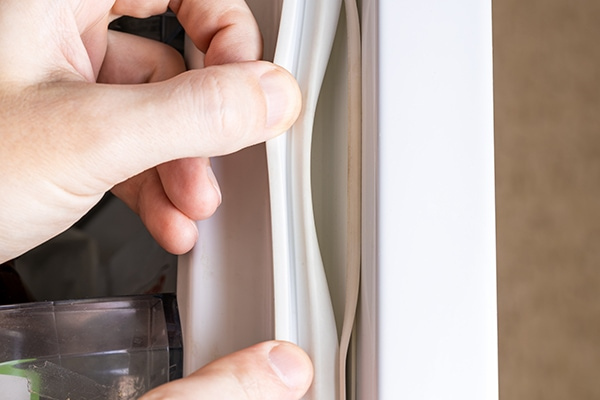 GE refrigerator door won't stay closed